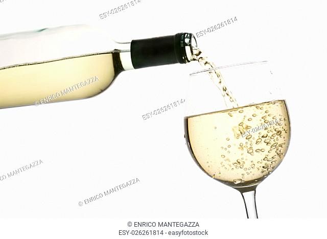 pouring white wine into glass, on white background