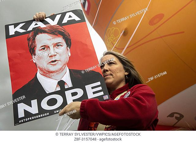 """Monica Veillet, of Deer Park, demonstrates against Judge Brett Kavanaugh's nomination to the U. S. Supreme Court in front of a giant """"""""Baby Trump"""""""" balloon on..."""
