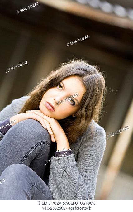 Teenager girl outdoors portrait sadness