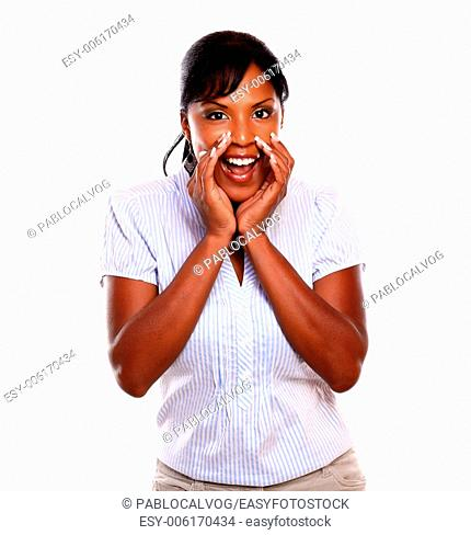 Lovely black young woman screaming to you on isolated background