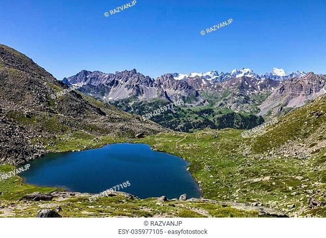 Snake lake (2448m) with view to Ecrins Massif and Mont Pelvoux (3932 m) locate on Claree Valley in Nevache, Hautes Alpes, France