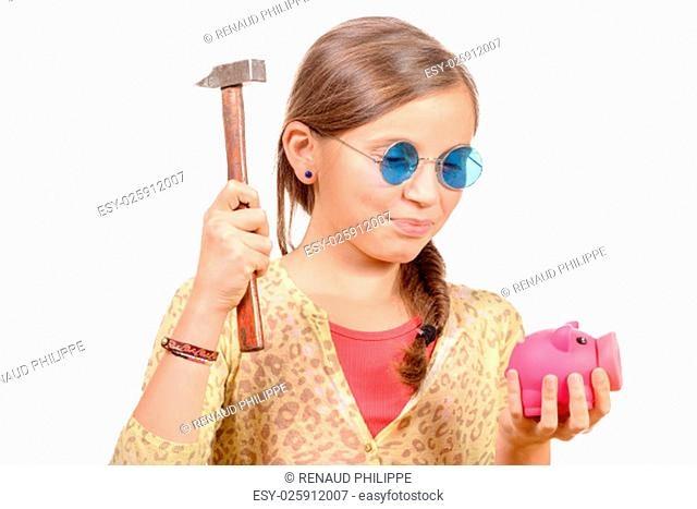 Little girl with hammer and piggy bank isolated on white background