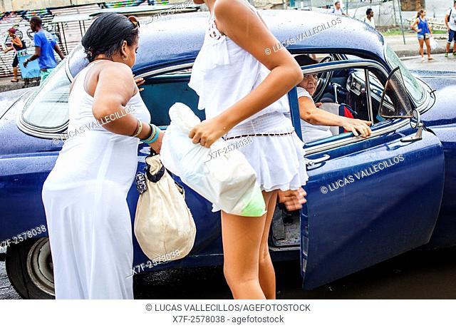 Women getting a taxi,in Dragones street, Centro Habana District, La Habana, Cuba