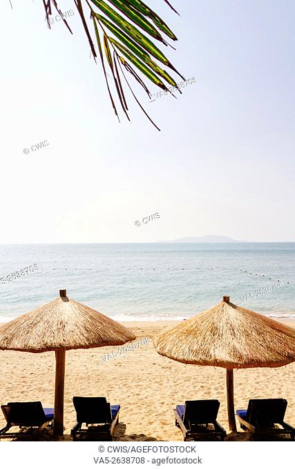Sanya, Hainan island, China - The view of beautiful beach in the daytime with beach chair