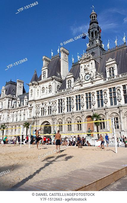Sportmen playing beach volley in front of the town hall of Paris,France