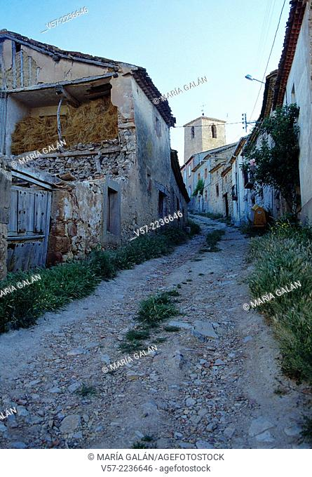 Lonely street and San Pedro church. Caracena, Soria province, Castilla Leon, Spain