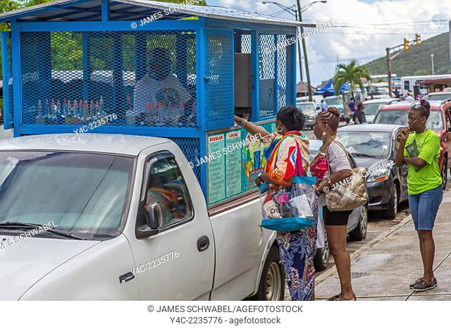 People getting food from food truck in Charlotte Amalie on the Caribbean island of St Thomas in the US Virgin Islands