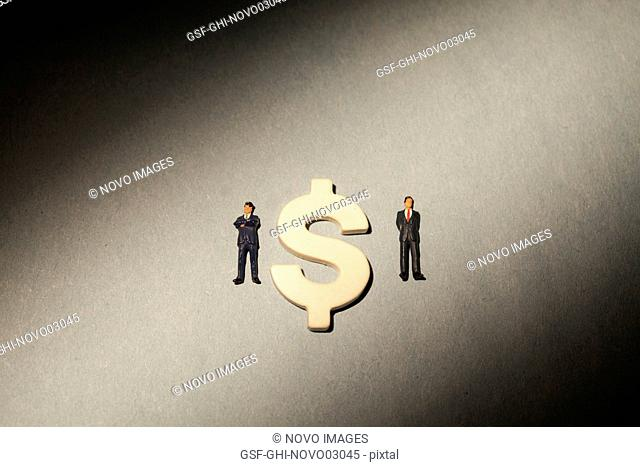 Dollar Sign and Two Miniature Figures of Businessmen