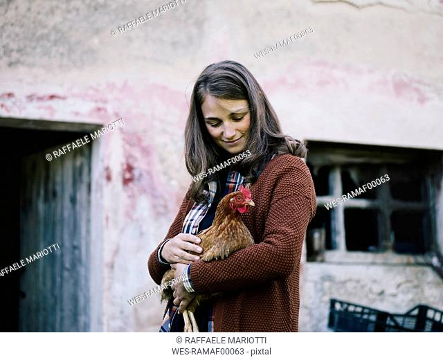 Smiling woman with chicken