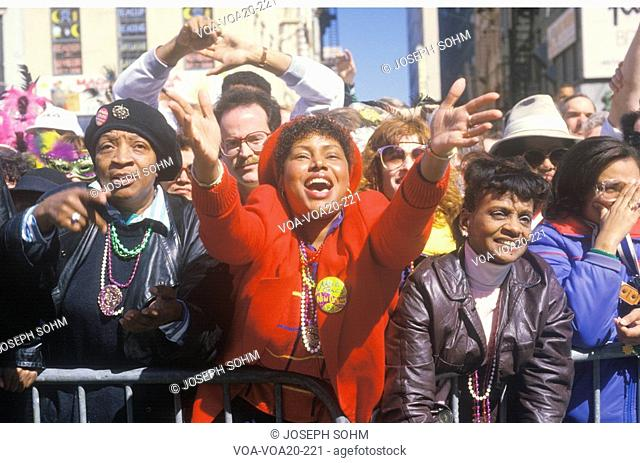 Joyous Spectators at Mardi Gras Parade and African American woman, New Orleans, Louisiana