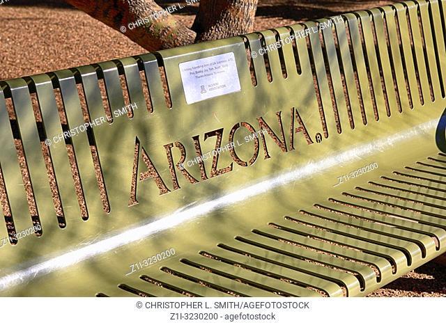 Metal park bench seat on the University of Arizona Campus in Tucson AZ