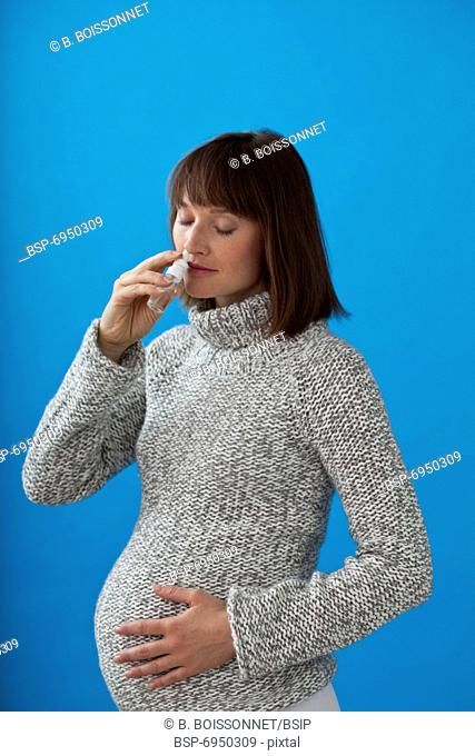 PREGNANT WOMAN WITH NOSE SPRAY Model