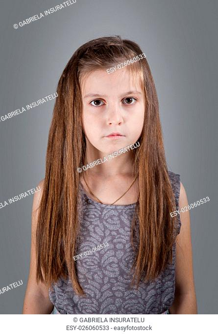 Portrait of a 8 year old girl, nicely dressed, studio shot