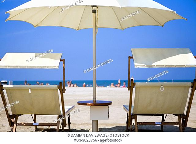 parasol and sun loungers on the beach, Rimini, Emilia-Romagna, Italy