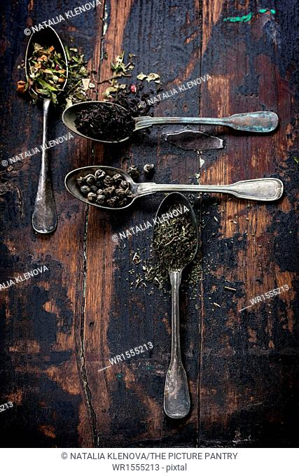 Various kinds of tea (black, green and herbal) on wooden background