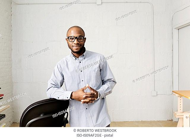 Portrait of young man in design office