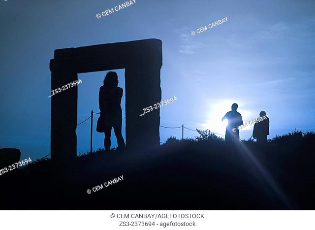 Silhouettes of the tourists at the famous Portara in town center, Naxos, Cyclades Islands, Greek Islands, Greece, Europe