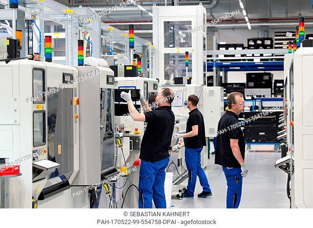 Staff members at work at the Accumotive factory in Kamenz, Germany, 22 May 2017. On the same day, the foundation stone for a new Accumotive battery factory was...