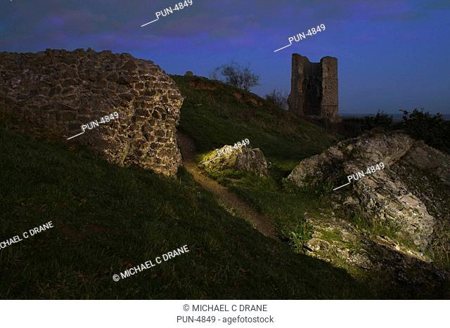 Ruined castle walls and tower of Hadleigh castle at twilight with lighting effects