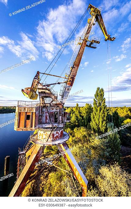 Rusty abandoned crane over Yanov Backwater in Chernobyl Nuclear Power Plant Zone of Alienation around the nuclear reactor disaster in Ukraine