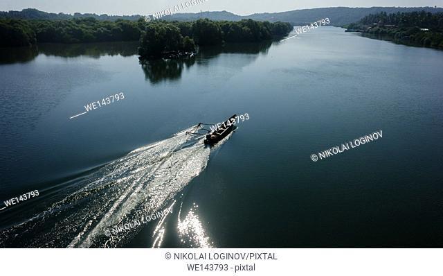 Indian boatman driving lake floating