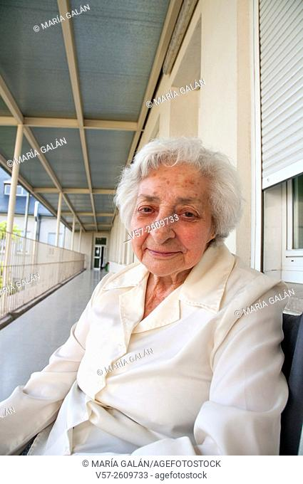 Portrait of old woman in a nursing home, smiling and looking at the camera