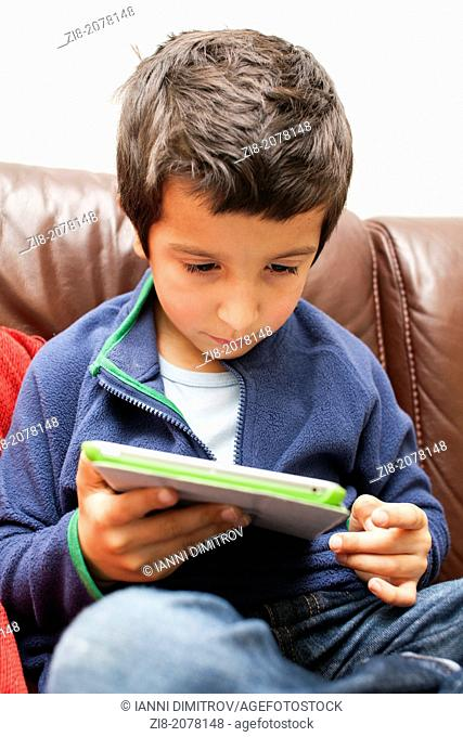 Young boy on a tablet tablet