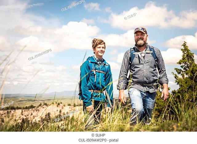 Father and teenage son on hiking trip, Cody, Wyoming, USA