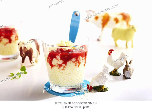 Vanilla rice pudding with strawberry sauce in small glasses