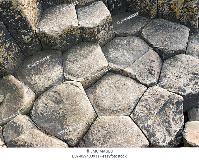 Hexagonal basalt pavement, a natural volcanic rock formation at the Giant's Causeway, County Antrim, Northern Ireland
