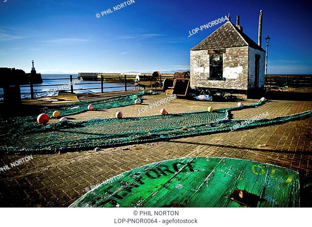 England, Cumbria, Maryport, Fishing nets laid out on the floor at Maryport Harbour