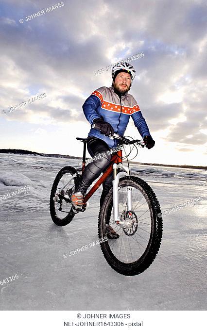 Mature man on mountain bike