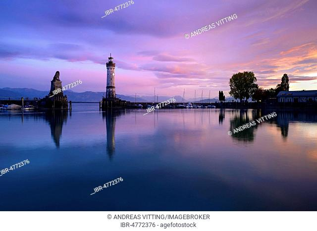 Harbour with lighthouse, sunset, water reflection, Lindau, Lake Constance, Bavaria, Germany