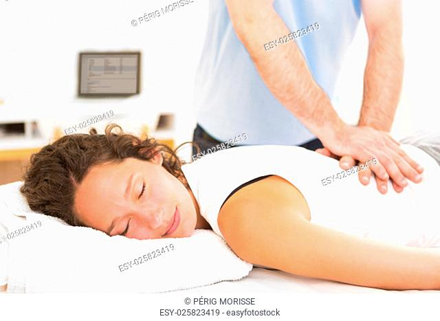 View of a Young attarctive woman being manipulated by physiotherapist