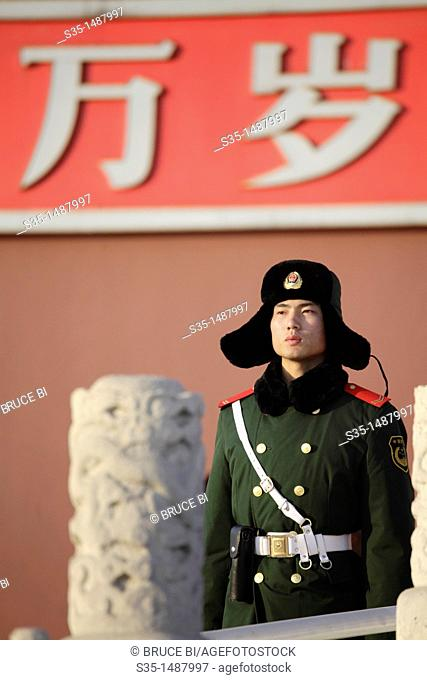 A military police guard in front of Gate of Heavenly Peace Tian An Men the main entrance of Forbidden City  Beijing  China