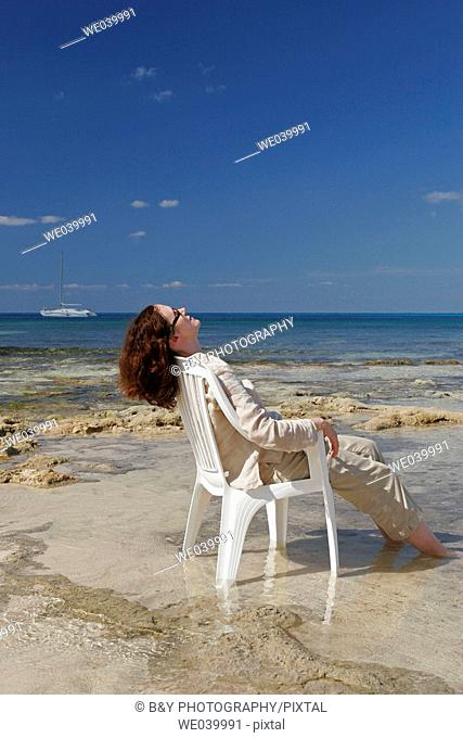 Woman resting on the beach. Cozumel, Mexico
