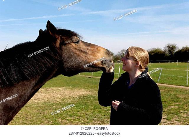 Girl Feeding her Horse