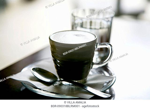 still life of coffee cup and glass of water