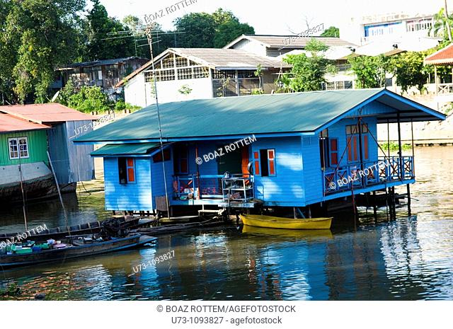 A colorful houseboat on the Chao Phraya river, Thailand