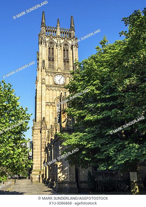 The clock tower at Leeds Minster in summer Leeds West Yorkshire England