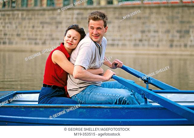 couple in a row boat