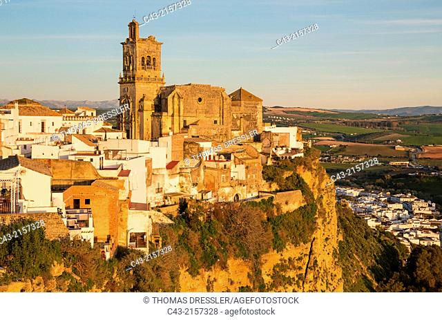 The historic district of the White Town of Arcos de la Frontera dramatically perches on a limestone crack high above the Guadalete river