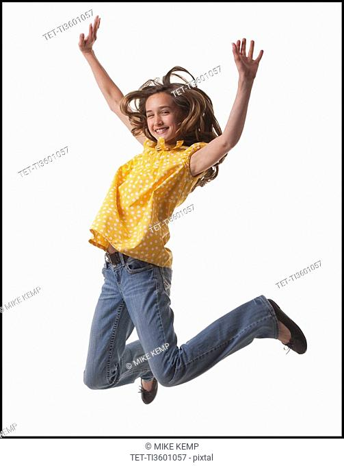 Excited teenage girl jumping for joy