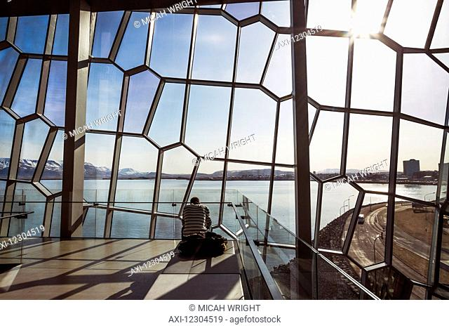 The unique designs of the Harpa concert hall and conference centre is free and open for all to experience and view; Reykjavik, Iceland