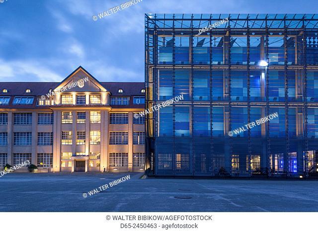 Germany, Baden-Wurttemburg, Karlsruhe, ZKM, Zentrum fur Kunst und Medientechnologie, modern art museum in former WW1-era munitions factory, exterior, dusk