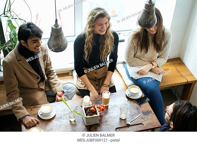 Friends meeting in a cafe