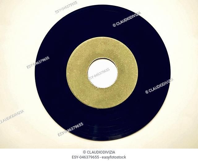 Vintage looking Single vinyl record vintage analog music recording medium 45 rpm green label