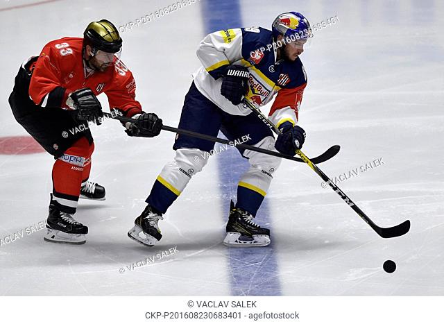 From left: Peter Pucher of Znojmo and Florian Kettemer of Munich in action during the Orli Znojmo vs EHC Red Bull Munchen Champions Hockey League F group game...