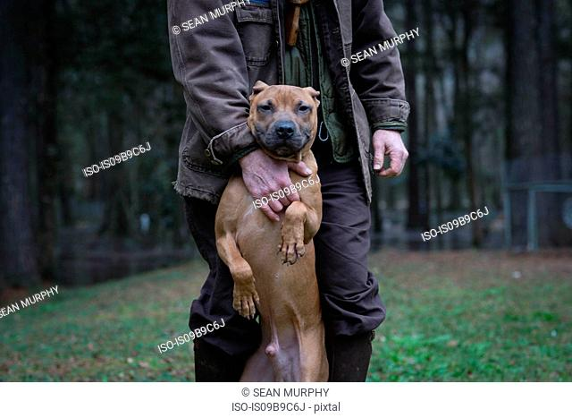 Man and pet dog standing on hind legs