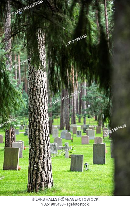 Grave stones and trees at skogskyrkogarden forest cemetery in Stockholm, Sweden